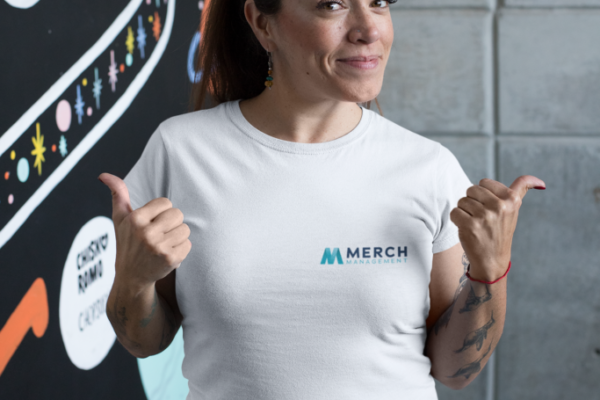 t-shirt-mockup-featuring-a-happy-customer-standing-by-an-art-wall-26210