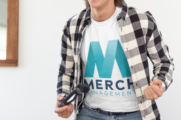 t-shirt-mockup-of-a-thrilled-gamer-standing-on-his-couch-26897